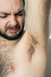 Funny man having bad smell from armpit Stock Photo