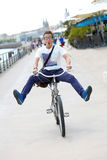 Funny man having fun riding bicycle in town Stock Photo