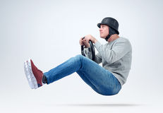 Funny man in helmet car driver with steering wheel. File contains a path to isolation. Royalty Free Stock Photography