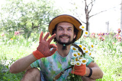 Funny man holding the camomile bouquet Stock Photos