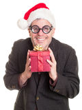 Funny man holding Christmas gifts royalty free stock photography