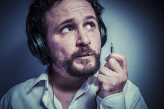 Funny, man with intense expression, white shirt Stock Photo