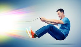 Funny man with joystick playing computer game, gamer concept. On background royalty free stock images