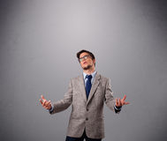 Funny man juggling with copy space Royalty Free Stock Images