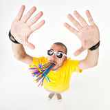 Funny man with juice straws in his mouth wearing sun glasses Stock Photos