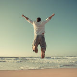 Funny man jumping at the beach Stock Photos