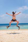 Funny man jumping in flippers and mask. Stock Image