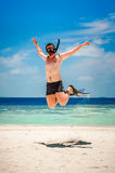 Funny man jumping in flippers and mask. Stock Photos