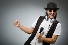 The funny man in karaoke club Stock Image