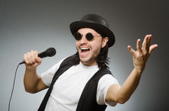 The funny man in karaoke club Royalty Free Stock Photo