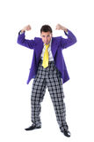 Funny man in large suit posing at camera Royalty Free Stock Photography