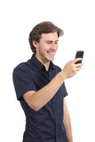 Funny man laughing using a smart phone. Isolated on a white background Royalty Free Stock Images