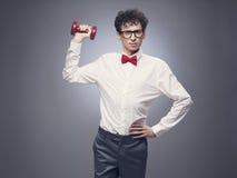 Funny man lifting weights royalty free stock photo