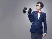 Funny man lifting weights royalty free stock image
