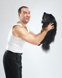 Funny man with little black dog Stock Photos