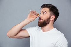 Funny man looking away through bulb Stock Images
