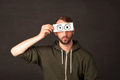 Funny man looking with hand drawn paper eyes Royalty Free Stock Image