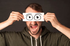 Funny man looking with hand drawn paper eyes Royalty Free Stock Photos