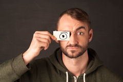 Funny man looking with hand drawn paper eyes Stock Photo