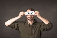 Funny man looking with hand drawn paper eyes Royalty Free Stock Photography