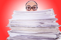 Funny man with lots of folders. On white Royalty Free Stock Photos