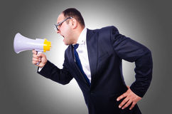 Funny man with loudspeaker. On white royalty free stock image