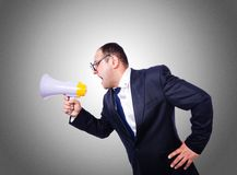Funny man with loudspeaker on the white Stock Photo