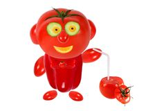 Funny man made of tomatoes and keeps tomato juice. Funny little man made ??of tomatoes and keeps tomato juice stock photography