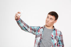 Funny man making selfie photo on smartphone Royalty Free Stock Images