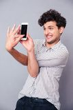 Funny man making selfie photo on smartphone Royalty Free Stock Image