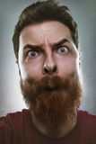 Funny man making silly face Stock Photography