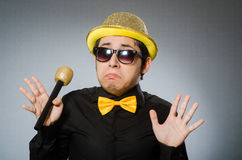 The funny man with mic in karaoke concept Royalty Free Stock Photos
