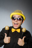 The funny man with mic in karaoke concept Stock Images
