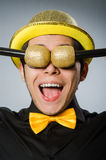 The funny man with mic in karaoke concept. Funny man with mic in karaoke concept Stock Photography