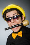 The funny man with mic in karaoke concept. Funny man with mic in karaoke concept Stock Image