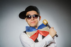 The funny man with mic in karaoke concept. Funny man with mic in karaoke concept Royalty Free Stock Images
