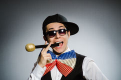 The funny man with mic in karaoke concept Royalty Free Stock Photography