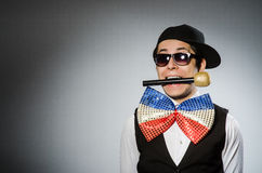 The funny man with mic in karaoke concept. Funny man with mic in karaoke concept Royalty Free Stock Image