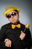 The funny man with mic in karaoke concept. Funny man with mic in karaoke concept Royalty Free Stock Photo