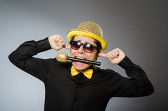 The funny man with mic in karaoke concept Royalty Free Stock Image
