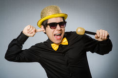 Funny man with mic in karaoke concept Royalty Free Stock Image