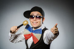 Funny man with mic in karaoke concept Stock Photo