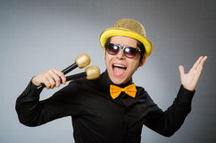 The funny man with mic in karaoke concept Stock Photography