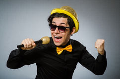 The funny man with mic in karaoke concept Stock Image