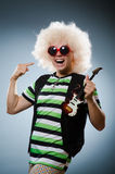 Funny man. With miniature guitar Royalty Free Stock Image