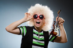 Funny man. With miniature guitar Royalty Free Stock Photos