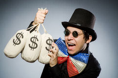 The funny man with money dollar sacks stock image