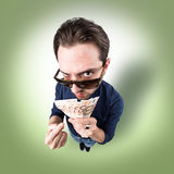 Funny man with money in his hands from above looking in camera Stock Image