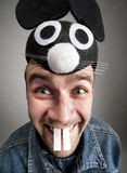Funny man in mouse hat. Portrait of funny man in mouse hat Stock Photography