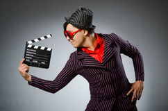 The funny man with movie board Stock Photo